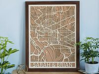 Cork map design on wood background with personalized couple names