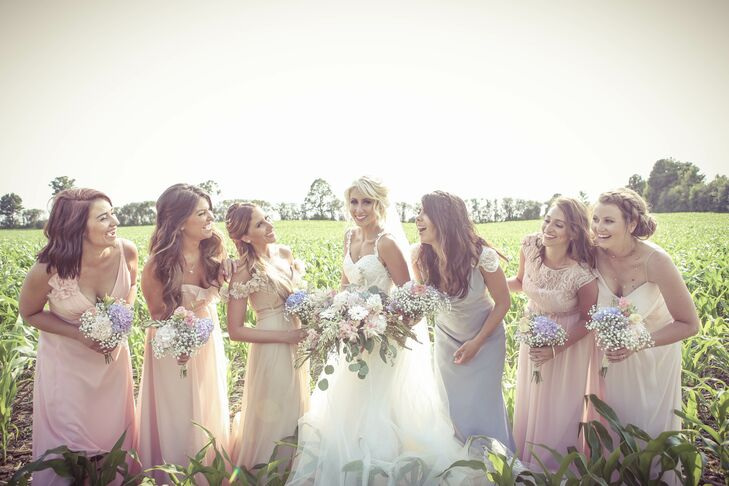 The bridesmaids chose their own chiffon dresses in pastel colors.