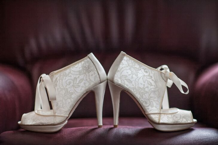 Ivory lace bridal bootees matched Francesca's vintage-glam bridal style.