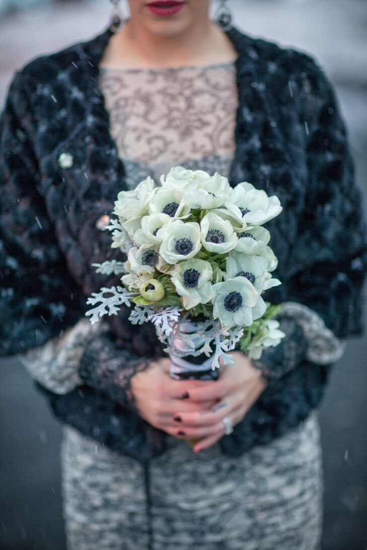 The bridesmaids held small bouquets of white anemones and dusty miller.