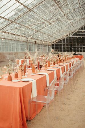 Long Reception Table with Coral Linens and Ghost Chairs