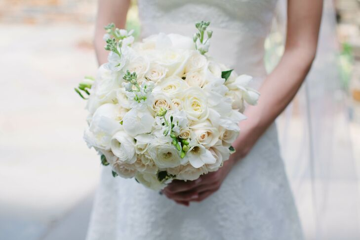 Sarah carried an understated white arrangement of roses, spray roses, garden roses, peonies, ranunculus and dusty miller.