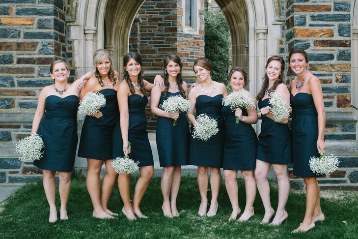 Sarah wanted all of her bridesmaids to wear navy but was taken by surprise when they each opted for the same style dress. Their baby's breath bouquets were wrapped with twine and popped against the J.Crew dresses.
