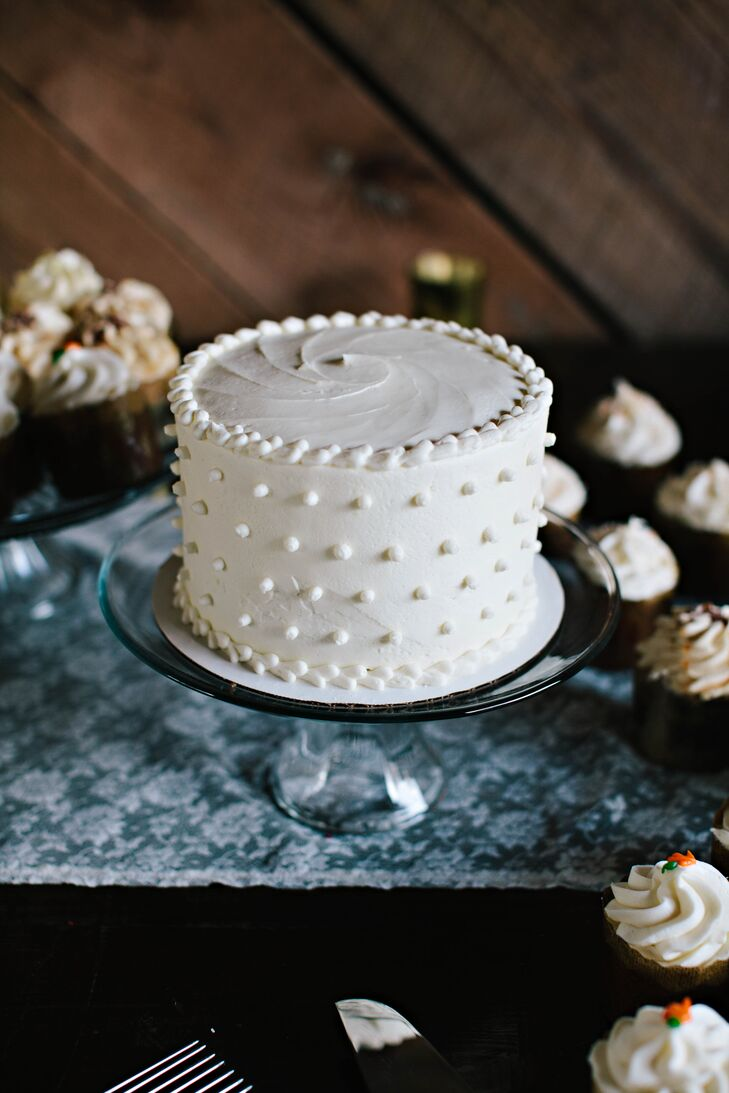 A delicate swiss dot pattern decorated the single tier carrot cake.