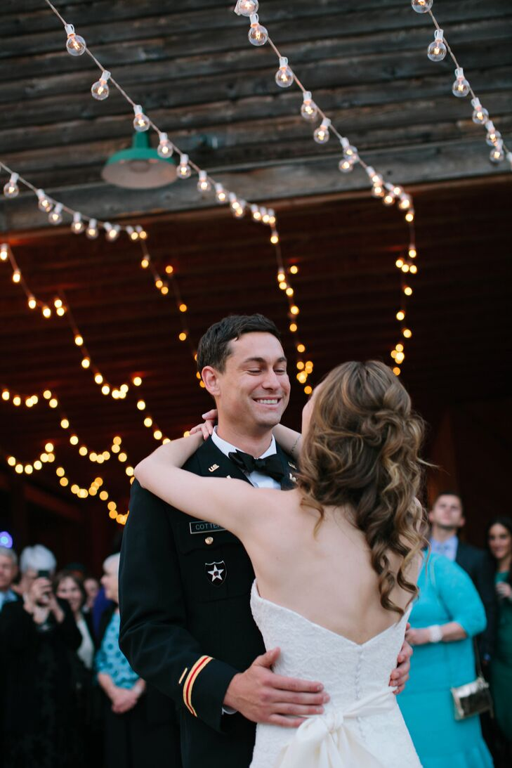 """After a tented sit-down dinner, guests moved into the family barn for a night of dancing. """"Once the band started, my grandma put on tennis shoes to go under her fancy dress and kept up with the best of them!"""" says Sarah."""