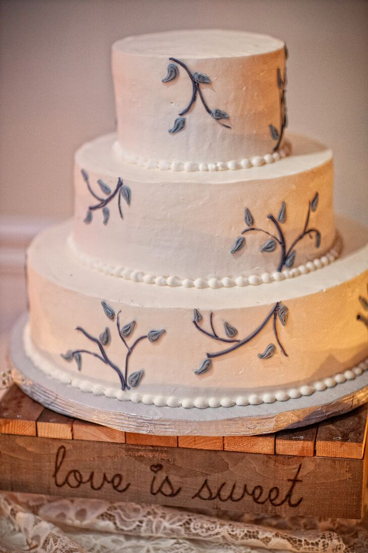 Three-Tier Buttercream Wedding Cake With Branch Accents