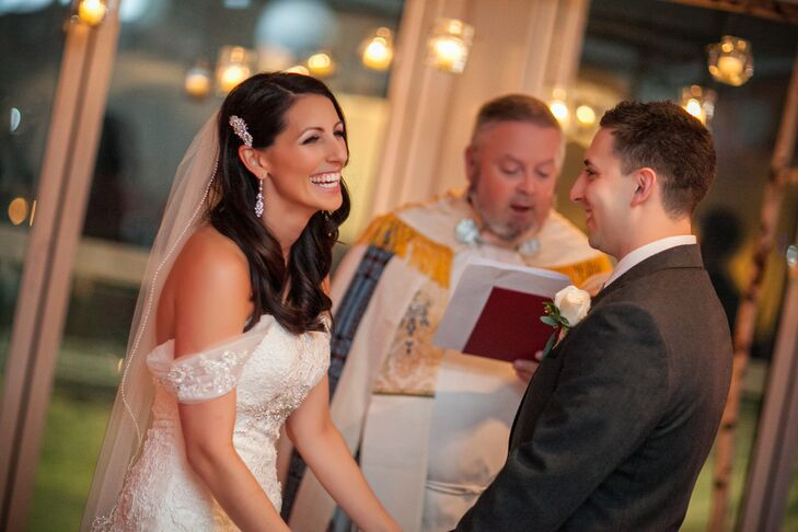 Bride Laughs During Candlelit Ceremony
