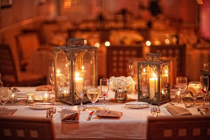 To accent numerous tables throughout the reception venue, Jessica and Angela from Angela Nicole Design bought lace filigree lanterns from Pottery Barn and complemented them with mercury votives.
