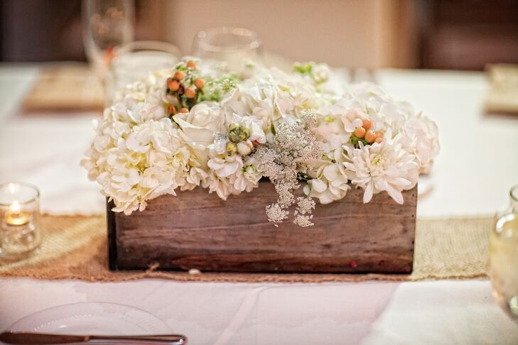 Angela from Angela Nicole Design placed white spray roses, white hydrangeas and Queen Anne's lace in wooden planter's boxes for the centerpieces of the dinner tables.