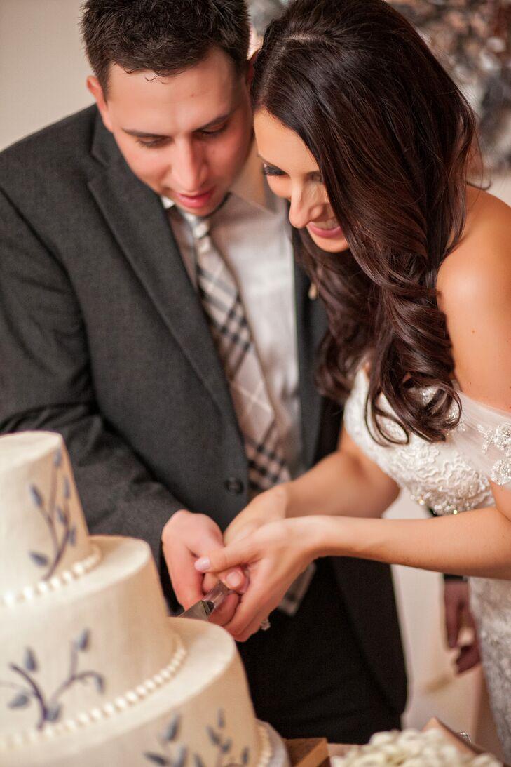Newlywed's Cutting Their Buttercream Wedding Cake
