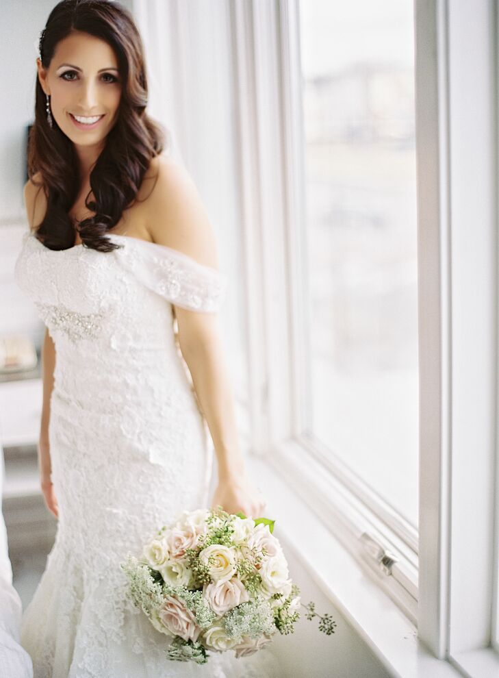 The Bridal Suite added the off-the-shoulder sleeves for Jessica during her first fitting, and they beautifully complemented the crystal details on the bodice of the dress.