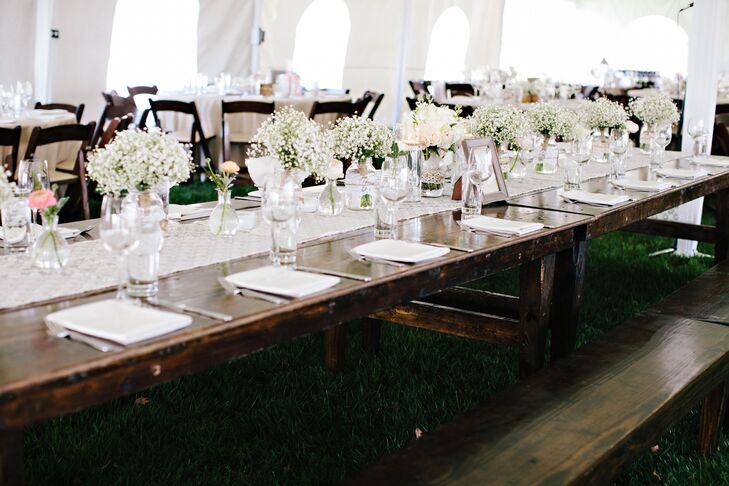 Understated rustic decor and soft florals transformed the bride's family farm for the romantic reception.