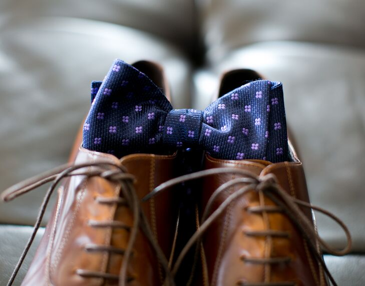 Matt accessorized his Ted Baker wedding suit with a navy bow tie from Ted Baker and brown leather shoes from Doucal's.