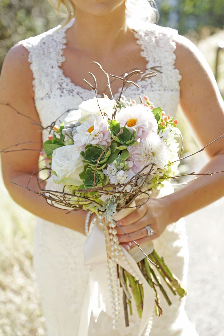 Miranda's bouquet consisted of succulents, zinnias, stock, silver brunia, hypericum berries and spray roses. She added twigs to tie in the natural theme and pearls to go with her vintage style.