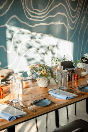 Blue, Orange and Yellow Tablescape with Wood Farm Table