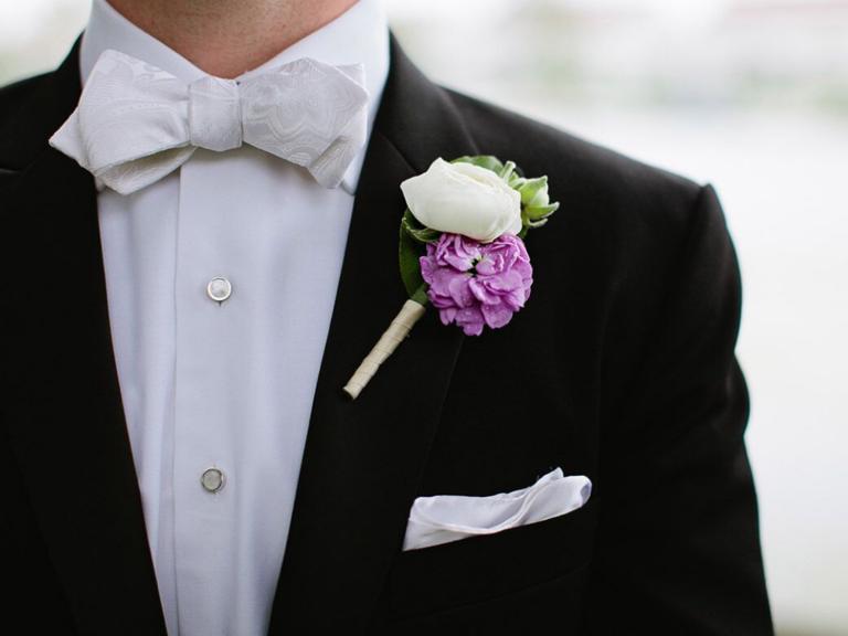 purple camellia and white rose boutonniere