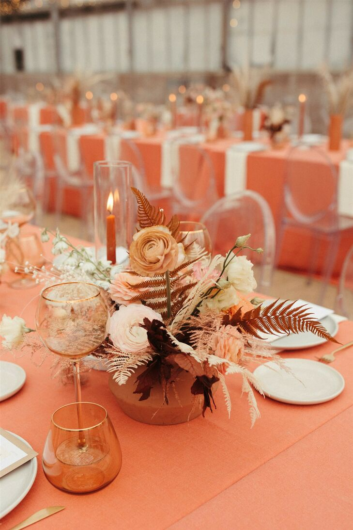 Coral-Hued Centerpiece with Ferns and Ranunculus