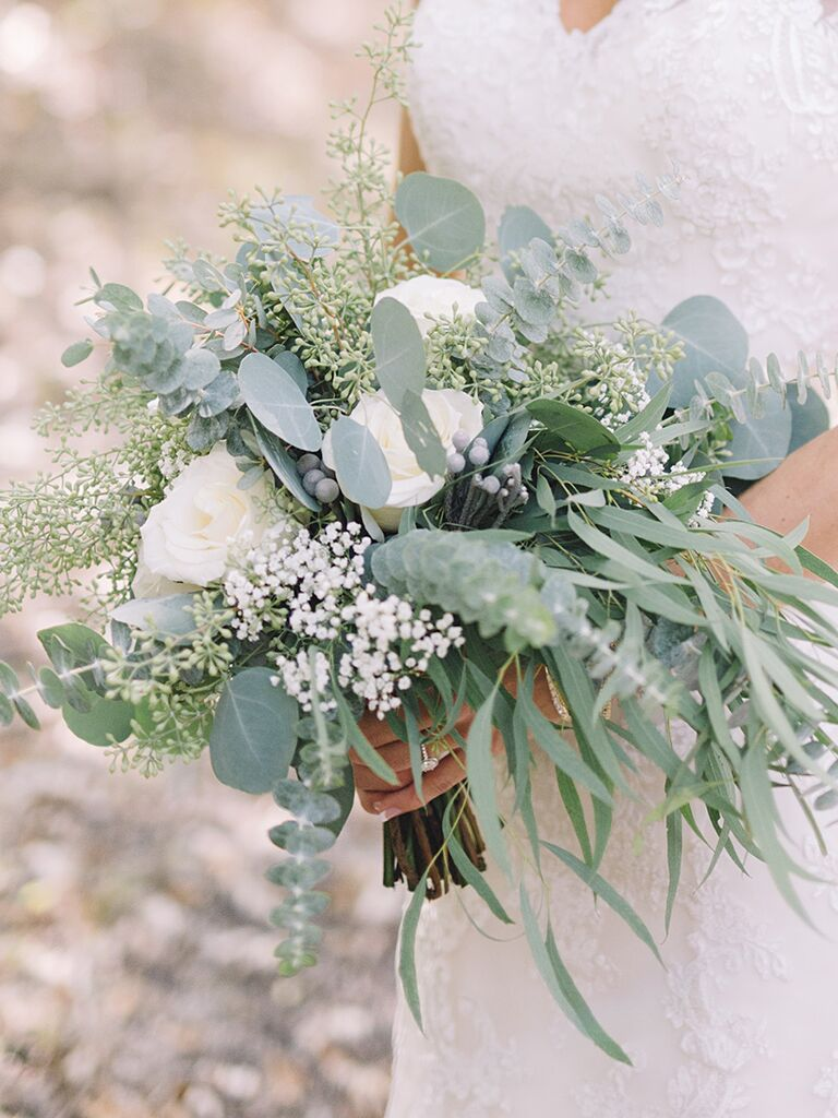 A bridal bouquet with roses and silver brunia