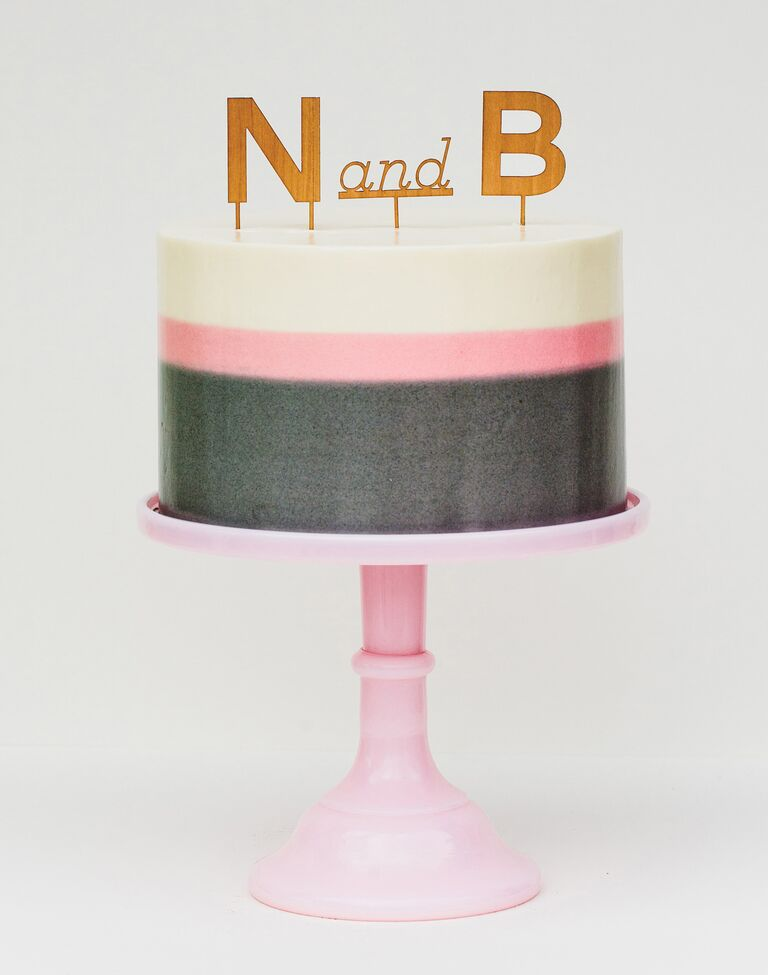 One-tier pink and white and gray bridal shower cake with monogram cake topper