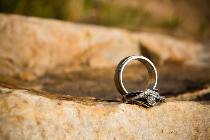 Grey proposed with a black-and-white geometric engagement ring with a round-cut diamond in the center.