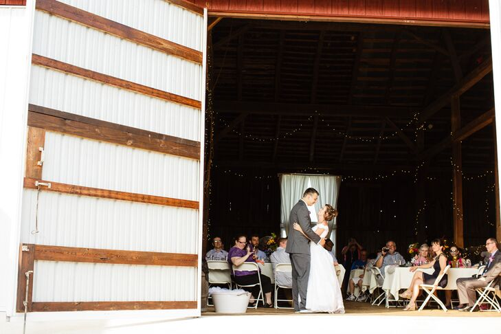"""The 18th-century Highland Vue Farms barn was also a big selling point for Kristie and Ryan. """"The owners have built onto it, but almost all the original barn is in tact,"""" Kristie says. The couple opened each barn door to let the natural light in and just highlighted the space with string lighting, white tables and folding chairs. The decor let Kristie and Ryan maintain a rustic, laid-back atmosphere as they took their first dance and celebrated with guests."""