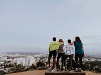 four woman standing on a los angeles hilltop