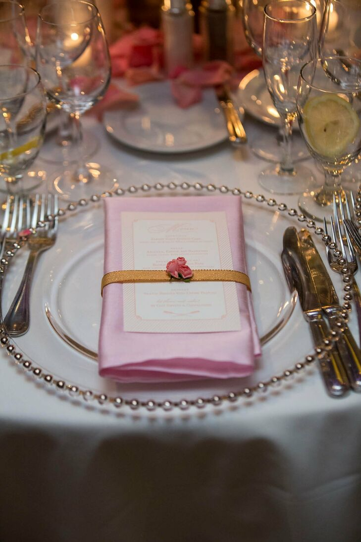 The pink napkins and menus felt regal and elegant thanks to gold ribbon, rose accents and silver chargers.