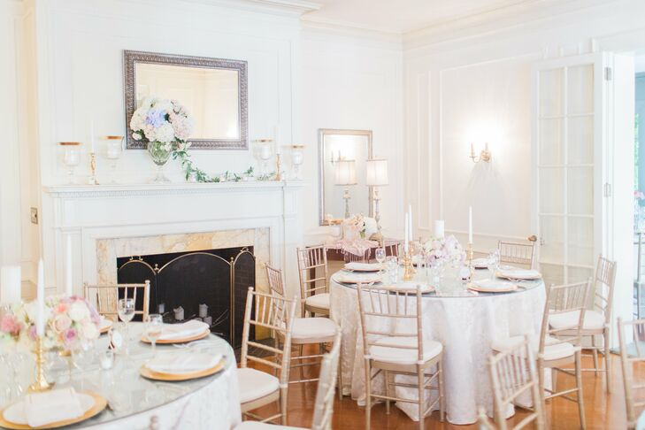 Gold chiavari chairs were used to play up the simplicity of the all-white room, where guests dined on watermelon and grapefruit mocktails during dinner.