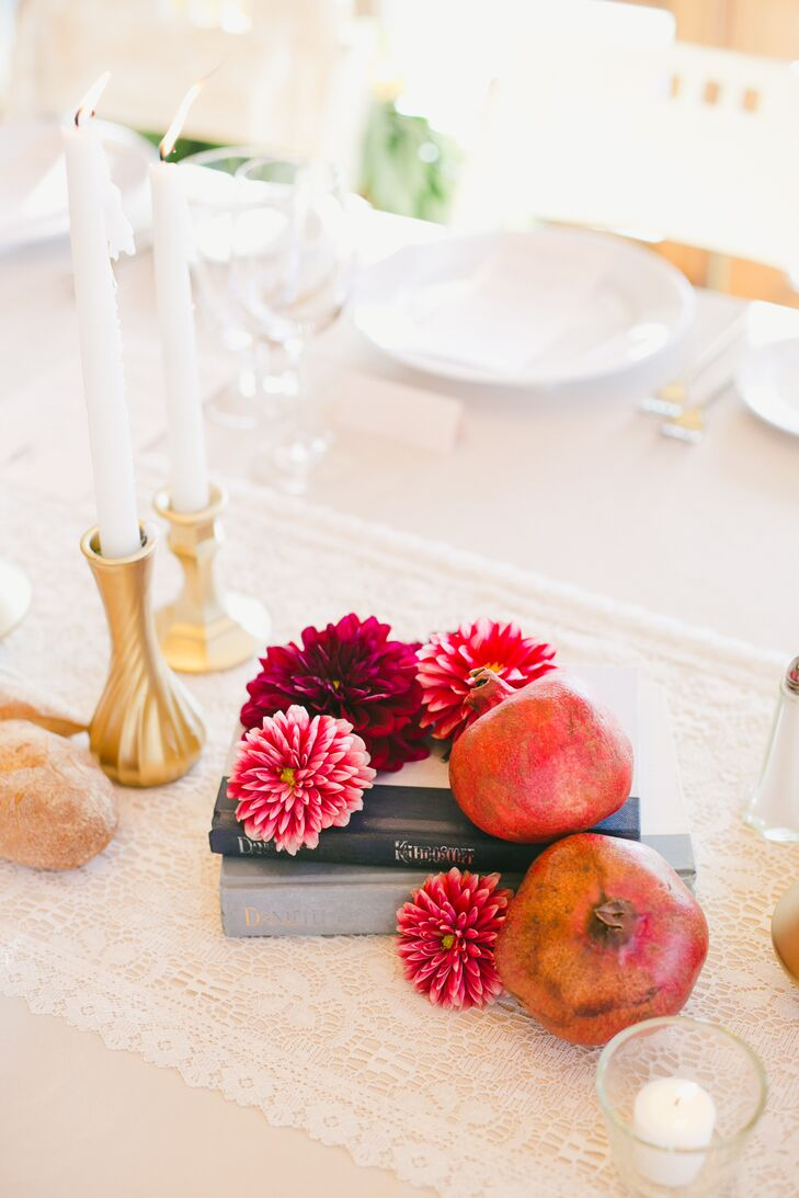 Unexpected elements like antique books and fruits injected an element of playfulness and personality into the reception decor.