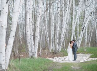 """The theme was rustic elegance when Cortney (32) ?and Mike (31, both in retail management) tied the knot at Charlevoix's Castle Farms. """"We wanted somet"""
