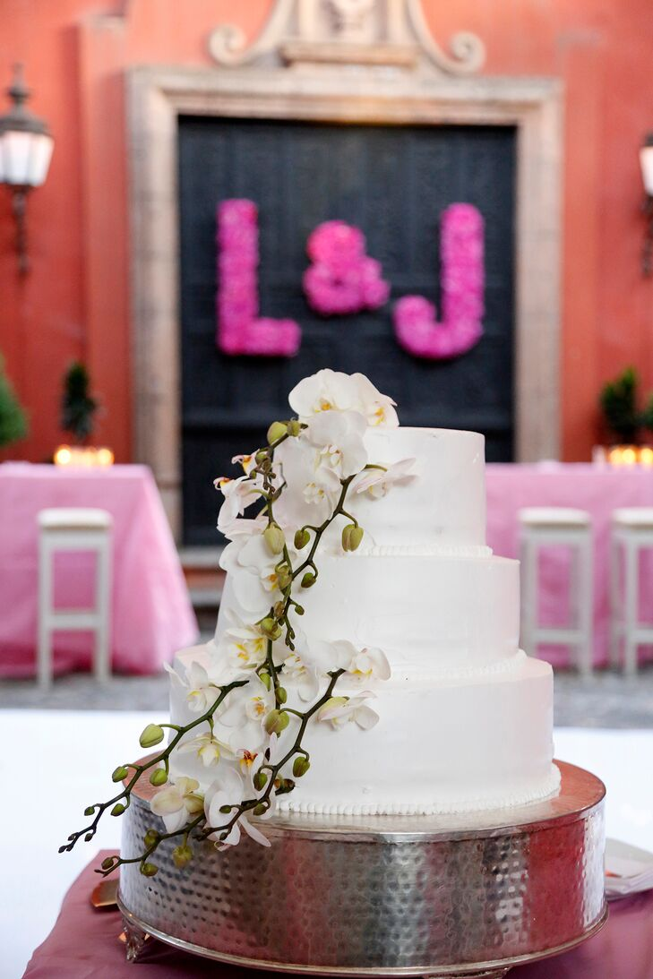 Even with all the vibrant colors in their wedding, Louisa and Joseph had a classic wedding cake. It had three round tiers with a cascade of white orchids down one side for a pretty touch.