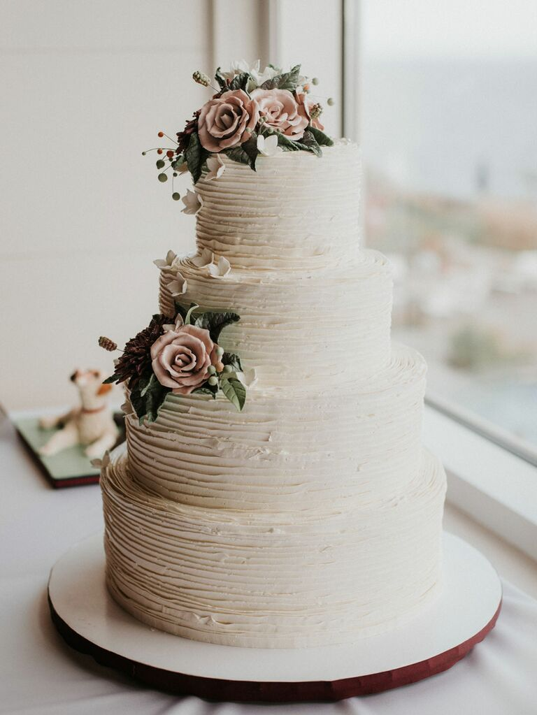 Rustic white wedding cake with light pink sugar flowers