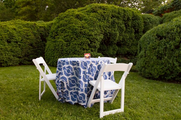 Cocktail hour was held on the South and Front Lawn of the home, with the guests intermingling between 100-year old boxwood bushes.