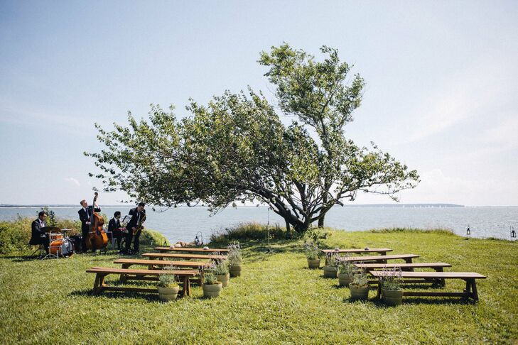 Lindsay and Jay held their ceremony under a cherry tree near the water in the bride's grandmother's yard.