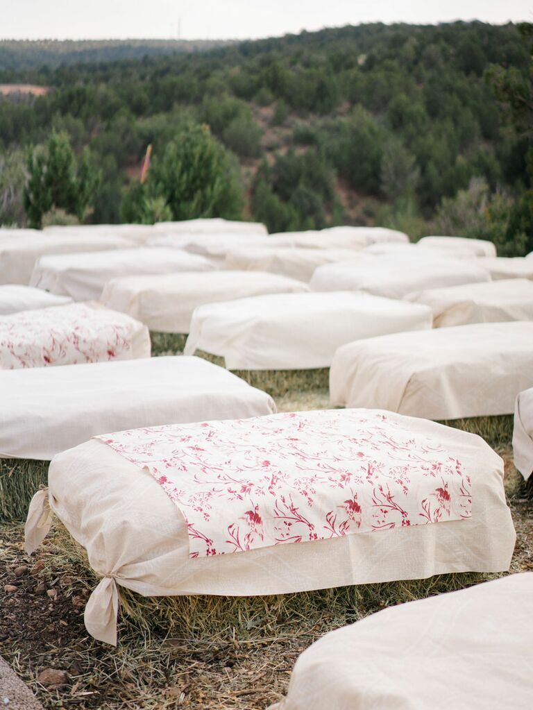 Hay bale seating at outdoor rustic barn wedding