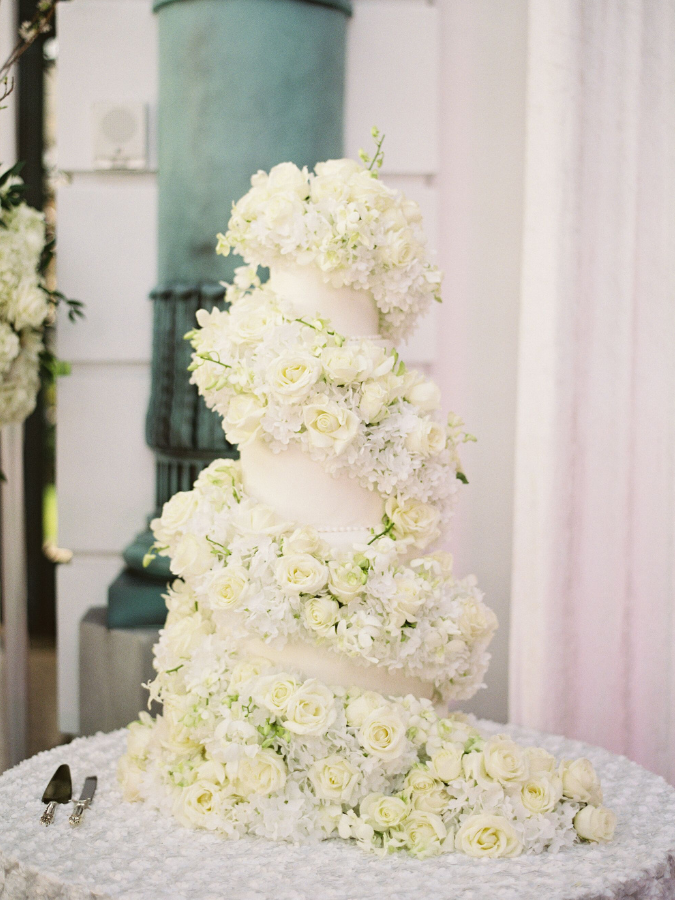 Cake with cascade of white fresh flowers