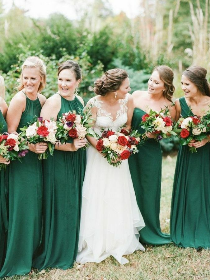 Wedding party portraits with bridesmaids in green dresses