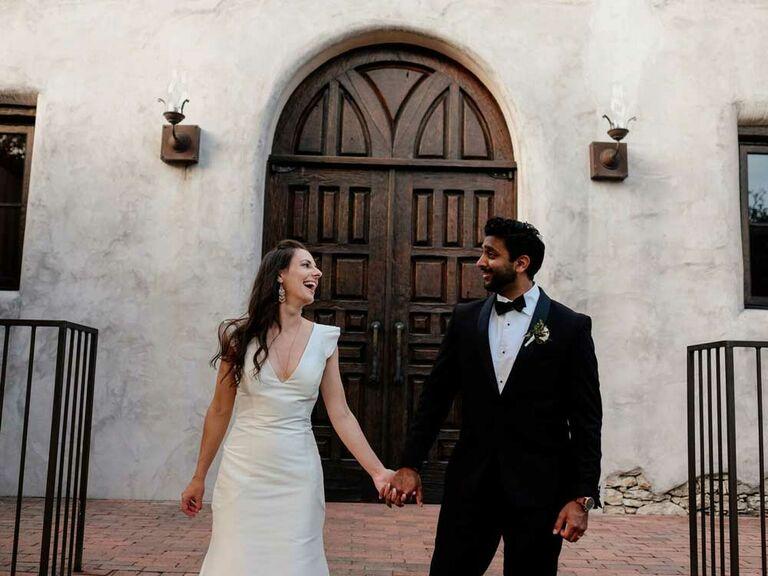Bride wearing simple wedding dress with groom
