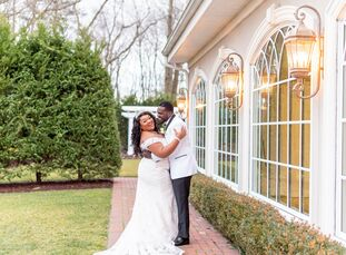 """Inspired by their estate venue's white-and-gold reception space, college sweethearts Tiana Wilson and Naeem Johnson, """"wanted a classic wedding that ex"""