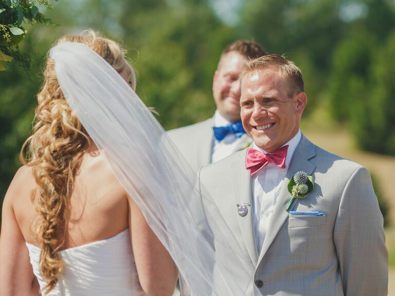 groom in pink bow tie and linen suit