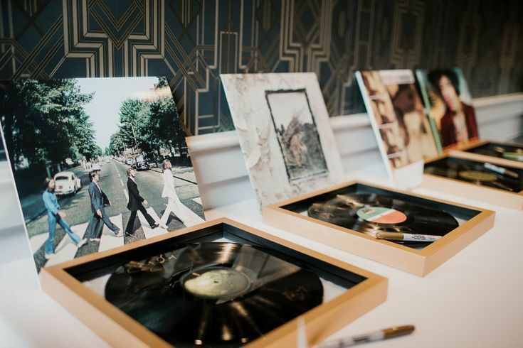 Vinyl records set on table as guest book activity