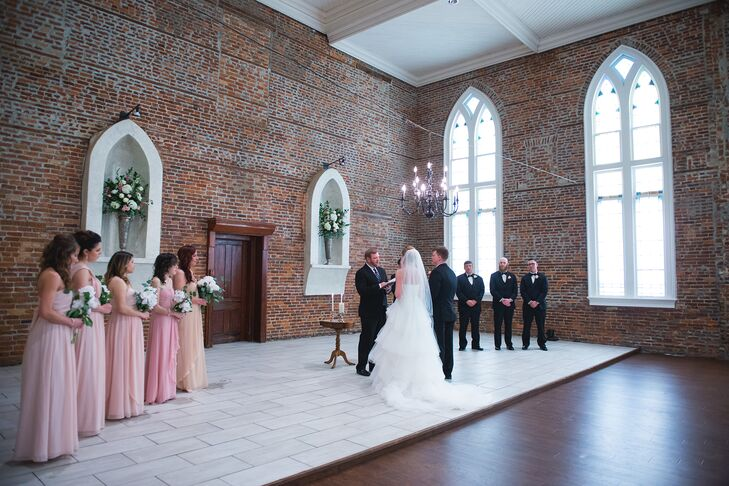 """The bridesmaids wore floor-length chiffon dresses designed by Jenny Yoo in shades of pink. The groomsmen wore black tuxedos with rose boutonnieres. """"The look was meant to be classic and timeless with a nod towards a Southern spring garden wedding,"""" Elizabeth says."""