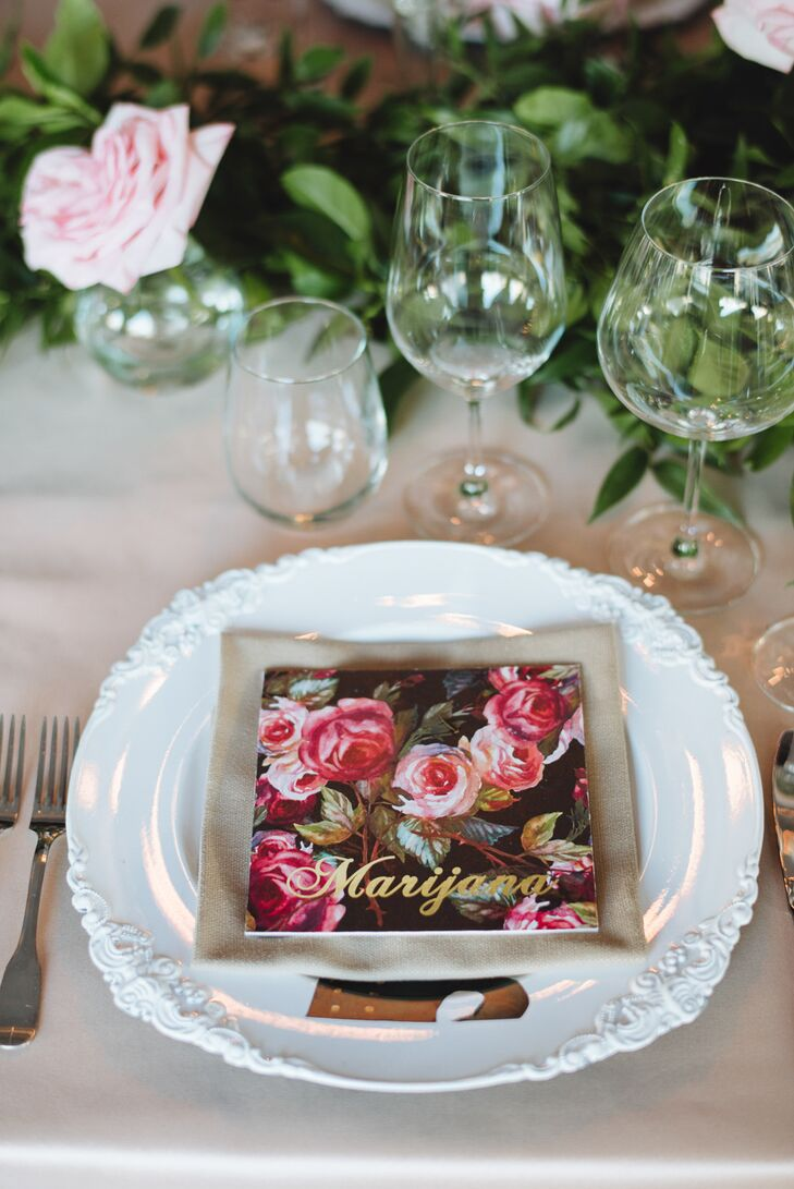 The newlyweds played up the secret garden theme with personalized botanical place cards adorned with gold script. The cards popped against intricate white dinnerware while drawing attention to the soft pink roses woven into the leafy garland that ran the length of the table.