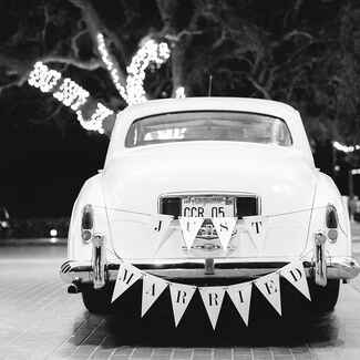 wedding getaway car with just married sign