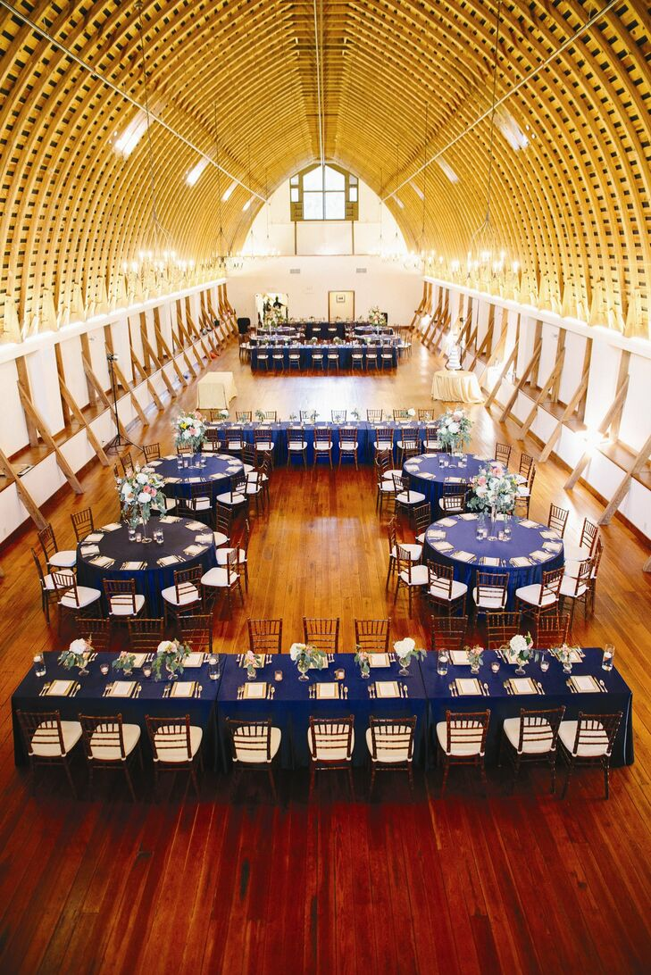Both long banquet tables and round tables were covered in navy tablecloths. The tables were spread out to make room for a dance floor in the middle of the loft.