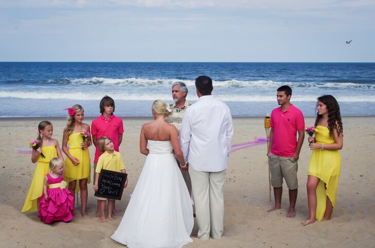 """""""I've always dreamed of a beach wedding: simple, barefoot and in the sand,"""" Amanda says. She and Jason were married  by the water on Croatan Beach in Virginia Beach, Virginia."""