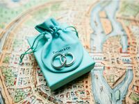 Tiffany & Co. jewelry drawstring bag with hoop earrings