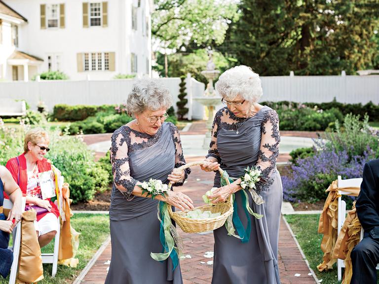 grandmother flower girls at wedding ceremony