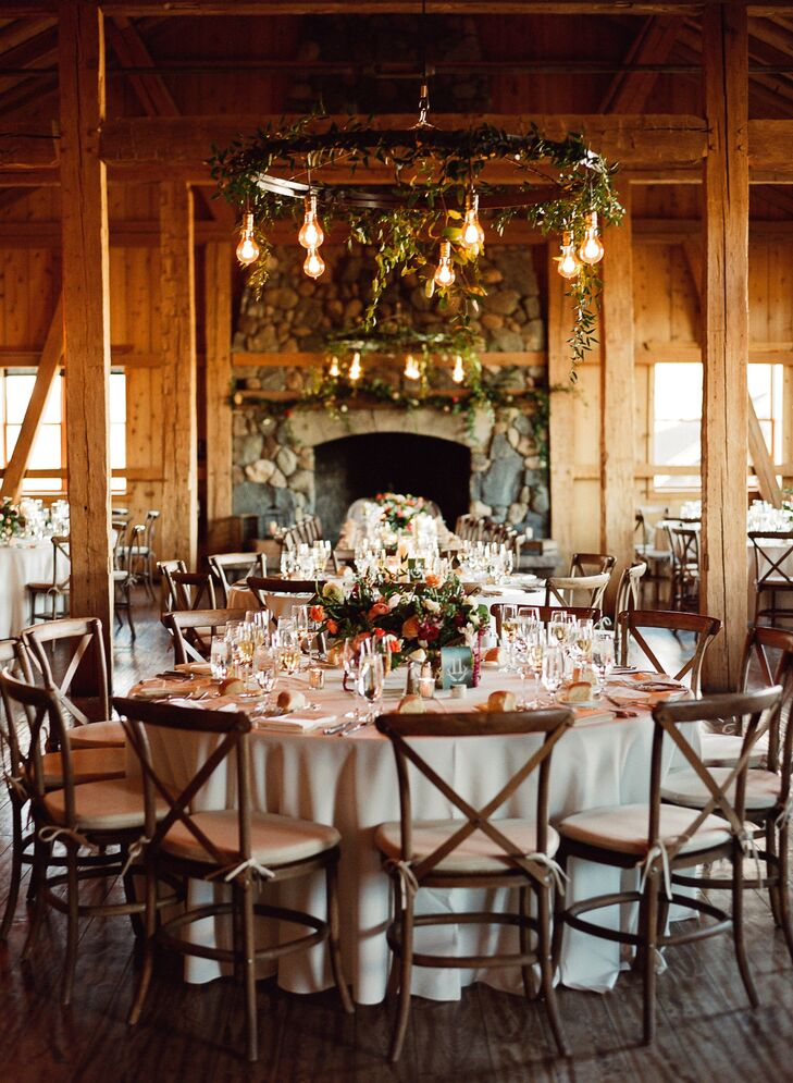 Edison bulb chandeliers, natural hanging greens and wildflowers in vases created a romantic ambiance in the rustic space at Devil's Thumb Ranch Resort & Spa in Tabernash, Colorado.
