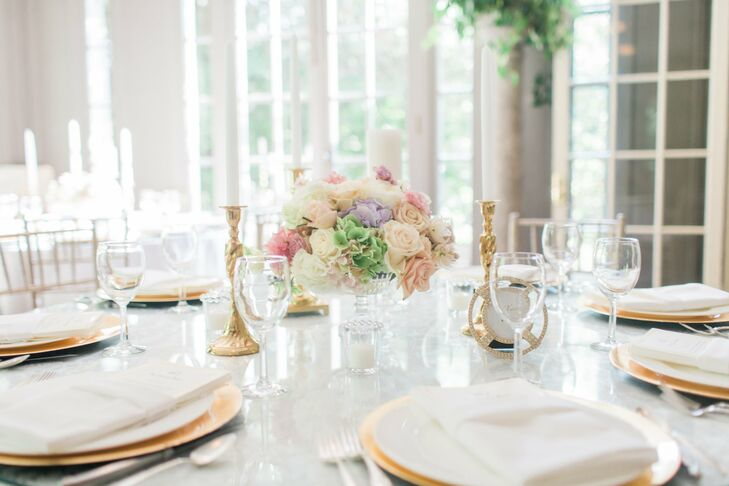 Gold flatware was used to play up  the simplicity of the all-white tablescapes, where guests dined on watermelon and grapefruit mocktails during dinner.